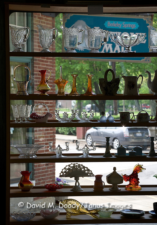 Berkeley Springs, West Virginia famous for natural hot springs. Glassware in window of antique shop in center of historic town.
