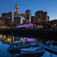 Boston North End Christopher Columbus Waterfront Park night photography from New England Photography Guild member and award winning fine art photographer Juergen Roth showing Boston Custom House of Boston, the waterfront and parts of the Columbus Park and Boston Marriott Long Wharf hotel. The Boston skyline was photographed on a beautiful spring sunset. <br /> <br /> Skyline photos of Boston are available as museum quality photo prints, canvas prints, wood prints, acrylic prints or metal prints. Fine art prints may be framed and matted to the individual liking and decorating needs:<br /> <br /> https://juergen-roth.pixels.com/featured/the-sudbury-grist-mill-juergen-roth.html<br /> <br /> All digital Boston skyline photography images are available for photo image licensing at www.RothGalleries.com. Please contact me direct with any questions or request.<br /> <br /> Good light and happy photo making!<br /> <br /> My best,<br /> <br /> Juergen<br /> Prints: http://www.rothgalleries.com<br /> Photo Blog: http://whereintheworldisjuergen.blogspot.com<br /> Instagram: https://www.instagram.com/rothgalleries<br /> Twitter: https://twitter.com/naturefineart<br /> Facebook: https://www.facebook.com/naturefineart