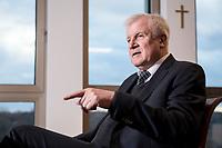 10 DEC 2016, BERLIN/GERMANY:<br /> Horst Seehofer, CSU, Bundesinnenminister, waehrend einem Interview, in seinem Buero, Bundesinnenministerium<br /> IMAGE: 20181210-02-022<br /> KEYWORDS; Büro, Kreuz