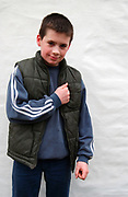 Little boy wearing a puffa jacket