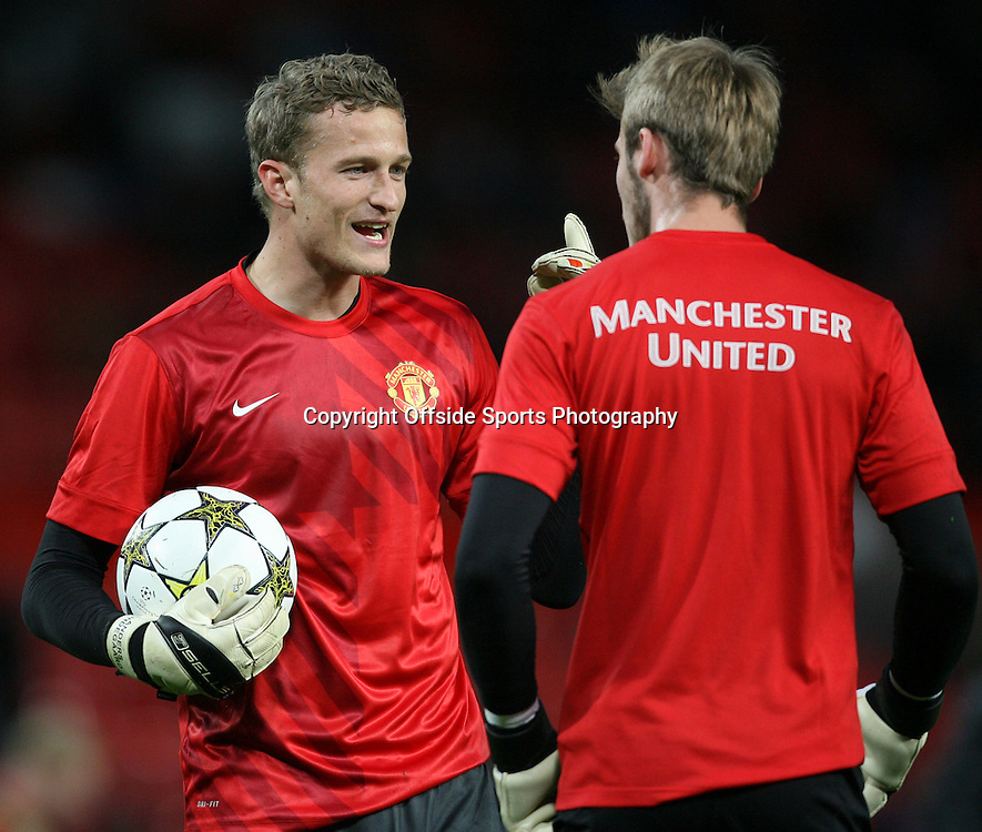19th September 2012 - UEFA Champions League (Group H) - Manchester United vs. Galatasaray - Man Utd goalkeeper Anders Lindegaard (L) talks to Man Utd goalkeeper David De Gea during the warm-up - Photo: Simon Stacpoole / Offside.