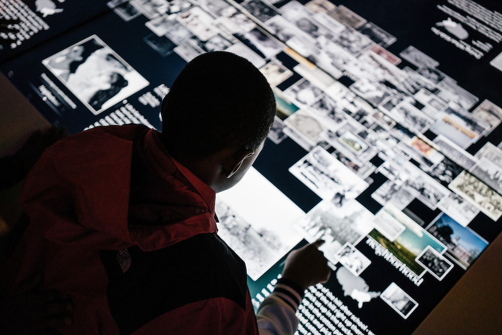 Sixth-graders from Knowledge Is Power Program (KIPP) DC, use an interactive display with historic photos inside the Smithsonian National Musuem of African American History and Culture during their visit on Oct 21, 2016. The students spent an hour touring the new Washington, D.C. museum, which is only available to see with reserved tickets during the first year.