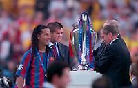 Photo: Richard Lane.<br />Arsenal v Barcelona. UEFA Champions League Final. 17/05/2006.<br />Barcelona's Ronaldinho looks on at the trophy.
