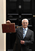 22/04/2009 Alistair Darling leaves number 11 Downing Street to deliver his budget to Parliament.