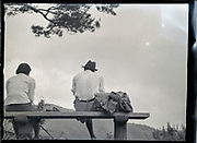 couple during a hiking trip at a mountain view lookout Japan ca 1950s