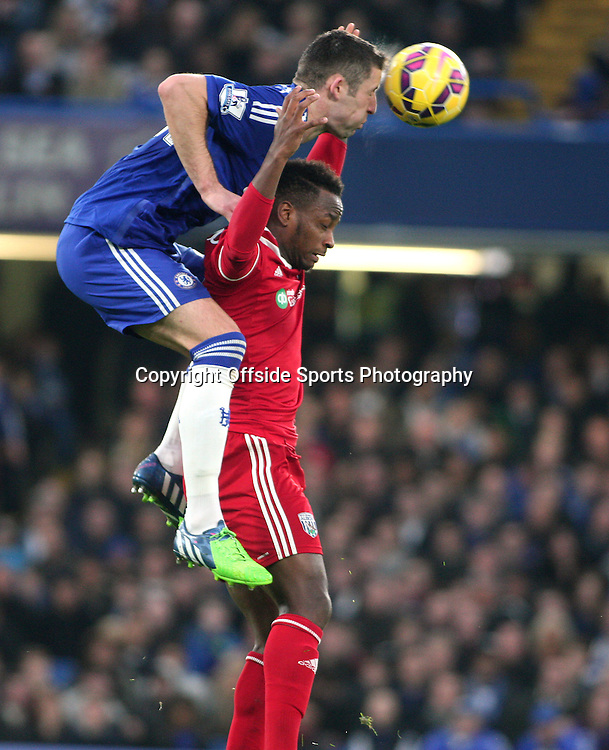 22 November 2014 - Barclays Premier League - Chelsea v West Bromwich Albion - Gary Cahill of Chelsea jumps on the back of Saido Berahino of Albion.<br /> <br /> <br /> Photo: Ryan Smyth/Offside