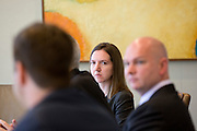 Amy Luberto, listens to James Colon, give remarks during an interview at Nuveen Asset Management in downtown Chicago, Ill., on Wednesday, September 23, 2015.