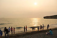Watch the sunset on Cijin Island's beautiful beach in Kaohsiung, Taiwan.
