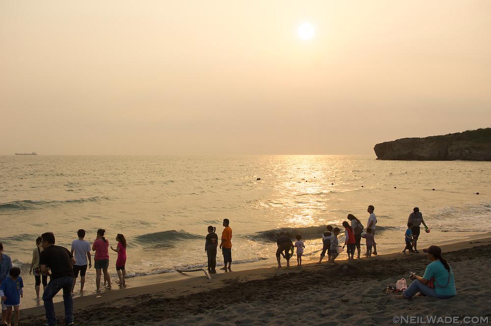 Watch the sunset on Cijin Island's beautiful beach in Kaohsiung, Taiwan.