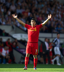 WEST BROMWICH, ENGLAND - Saturday, August 18, 2012: Liverpool's Luis Alberto Suarez Diaz in action against West Bromwich Albion during the opening Premiership match of the season at the Hawthorns. (Pic by David Rawcliffe/Propaganda)