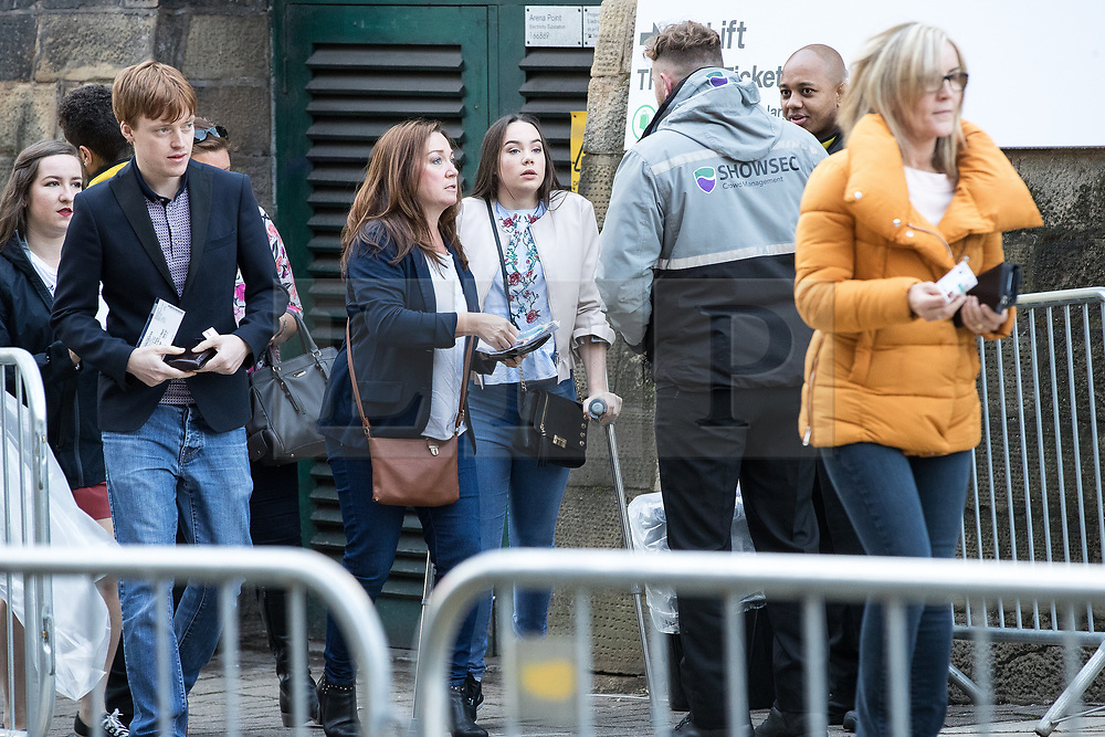 © Licensed to London News Pictures . 09/09/2017. Manchester , UK . Concert goers arrive at the venue . We Are Manchester reopening charity concert at the Manchester Arena with performances by Manchester artists including  Noel Gallagher , Courteeners , Blossoms and the poet Tony Walsh . The Arena has been closed since 22nd May 2017 , after Salman Abedi's terrorist attack at an Ariana Grande concert killed 22 and injured 250 . Money raised will go towards the victims of the bombing . Photo credit: Joel Goodman/LNP