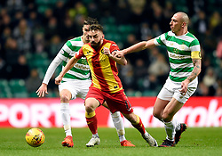 Partick's Steven Lawless gets away from Celtic's Scott Brown during the Scottish Premiership match at Celtic Park, Glasgow.