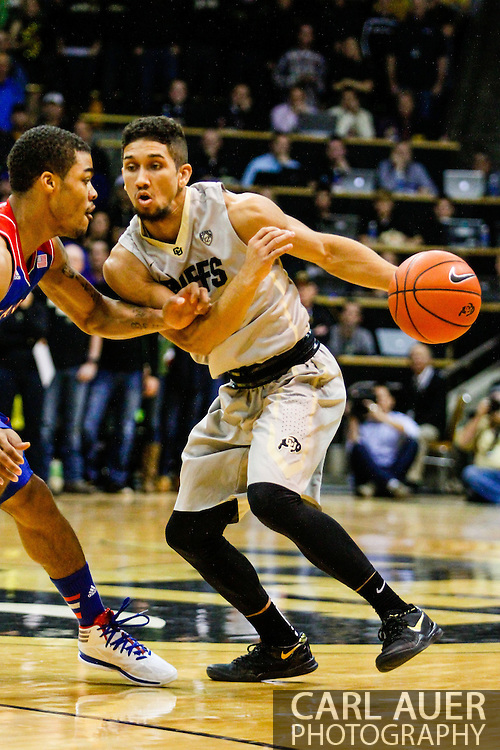 December 7th, 2013:  Colorado Buffaloes junior guard Askia Booker (0) attempts to drive the ball past Kansas Jayhawks freshman guard Frank Mason (0) in the first half of the NCAA Basketball game between the Kansas Jayhawks and the University of Colorado Buffaloes at the Coors Events Center in Boulder, Colorado