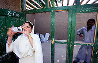 JURM, 28 July 2005....UNFPA employee, Dr Farida Khoshdil, takes  pictures of the construction site at the Ghyasi Boys High School. ..The school's extension is funded by UNFPA