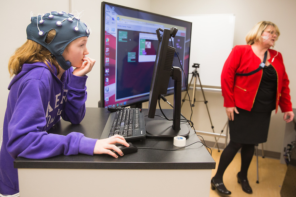 Alexis Grow, 12, a sixth-grade student at Sunnyside Elementary in Pullman, Wash., wears an EEG device which measures brain activity while Laura Grant, a teacher with Sunnyside Elementary, provides instruction for a lesson during a field trip to the Washington State University neurocognition sciene lab Monday, Feb. 22, 2016.