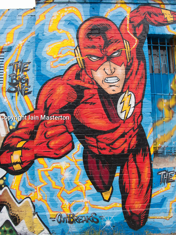 Large graffiti painting of comic book superhero on wall in Kreuzberg Berlin Germany