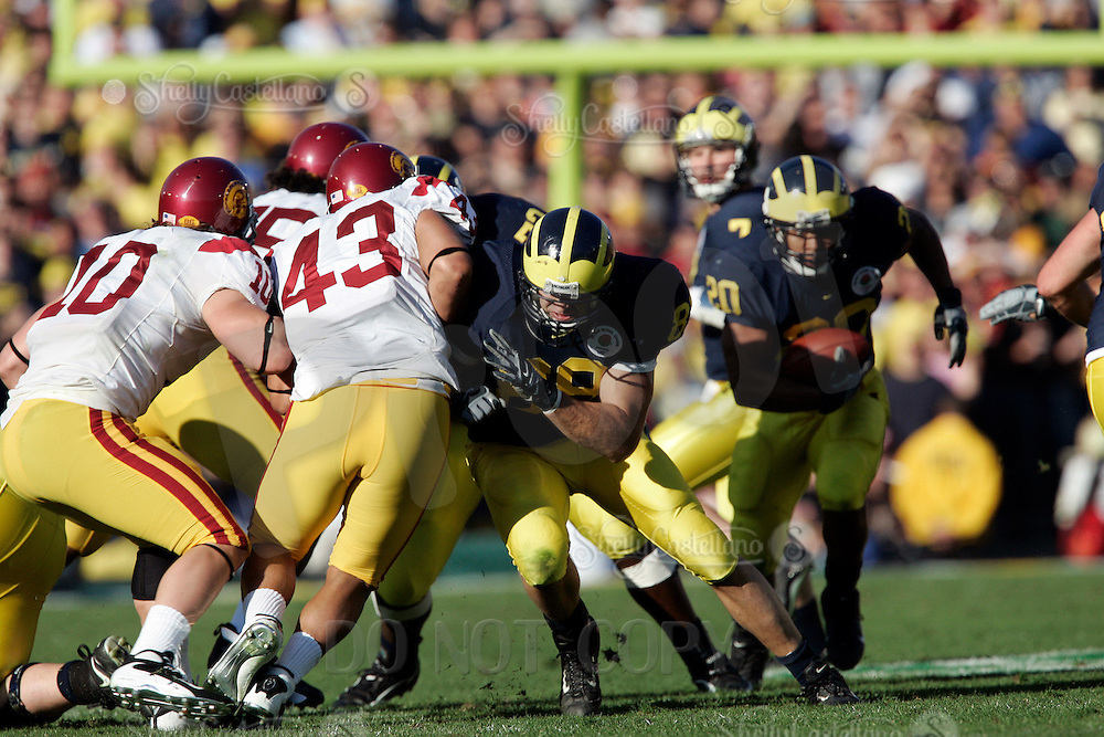 1 January 2007: #89 Tyler Ecker blocks Kaluka Maiava to make way for Mike Hart to rush  at the 93rd Rose Bowl Game at the Rose Bowl Stadium for the Pac-10 USC Trojans vs the Big-10 Michigan Wolverines NCAA college football game in Southern California.  Trojans defeated the Wolverines 32-18 in regulation.<br />