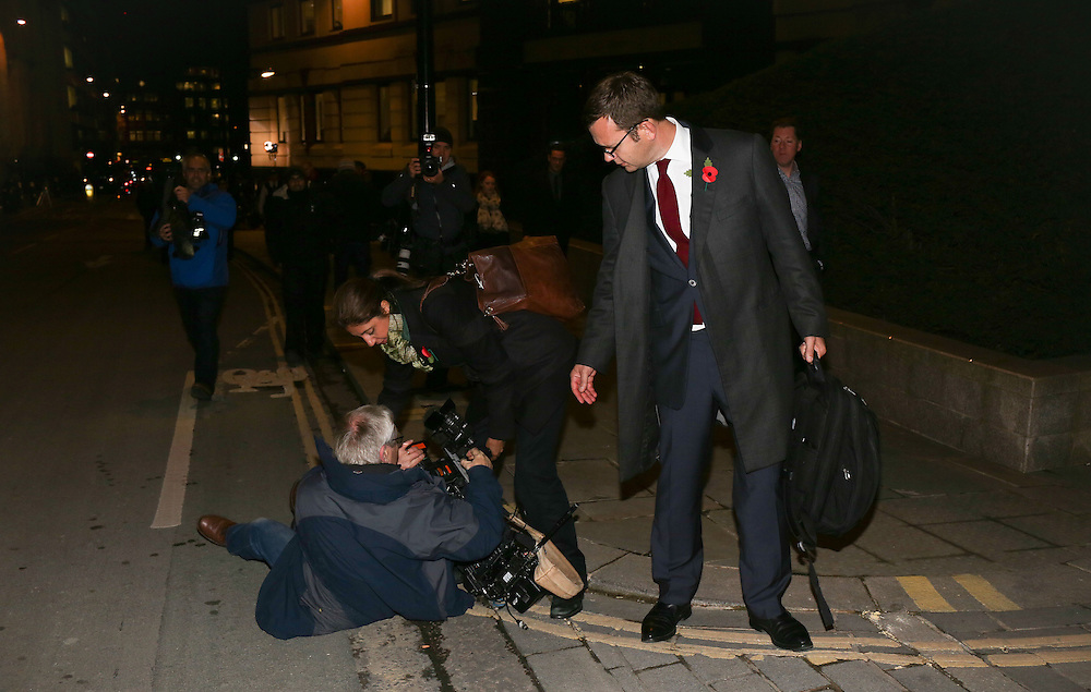 Andy Coulson offers a hand to the cameraman who was knocked over in the scrum as he leaves the Old Bailey after it was revealed that Coulson &amp; Brooks had a six year affair on October 31, 2013.<br /> <br /> Brooks will stand trial alongside former managing editor Stuart Kuttner; former news editor Ian Edmondson; and Rebekah Brooks. All deny conspiracy to intercept mobile phone voicemail messages. Coulson and former NotW royal editor Clive Goodman deny charges of conspiracy to commit misconduct in a public office. Brooks also denies two charges of this. She also faces charges of conspiracy to pervert the course of justice, along with former personal assistant Cheryl Carter, 49, husband Charlie Brooks, 50, and NI head of security Mark Hanna, 50. <br /> Photo Ki Price