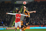 Hull City midfielder David Meyler (7) gets to the ball before Mohamed Elneny of Arsenal FC (35)  during the The FA Cup fifth round match between Hull City and Arsenal at the KC Stadium, Kingston upon Hull, England on 8 March 2016. Photo by Ian Lyall.
