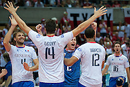Antonin Rouzier from France with his team mates celebrate winning point and victory after the 2013 CEV VELUX Volleyball European Championship match between Poland and France at Ergo Arena in Gdansk on September 21, 2013.<br /> <br /> Poland, Gdansk, September 21, 2013<br /> <br /> Picture also available in RAW (NEF) or TIFF format on special request.<br /> <br /> For editorial use only. Any commercial or promotional use requires permission.<br /> <br /> Mandatory credit:<br /> Photo by © Adam Nurkiewicz / Mediasport