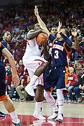 FAYETTEVILLE, AR - DECEMBER 19:  Alandise Harris #2 of the Arkansas Razorbacks goes up for a shot past Terence Smith #3 of the UT Martin Skyhawks at Bud Walton Arena on December 19, 2013 in Fayetteville, Arkansas.  The Razorbacks defeated the Skyhawks 102-56.  (Photo by Wesley Hitt/Getty Images) *** Local Caption *** Alandise Harris; Terence Smith