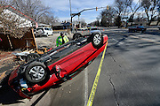 Longmont Police investigate a single vehicle rollover crash on 17th Avenue near Collyer Street on Monday, Feb. 2, 2015.<br /> <br /> (Matthew Jonas / Longmont Times-Call)