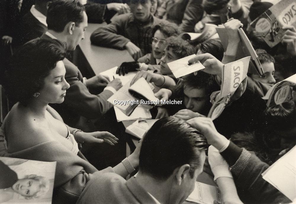 Paris, 1955, famous French movie star<br /> Martine Carol at the &quot;Kermesse des Etoiles&quot; signing autographs.<br /> <br /> Paris, 1955, c&eacute;l&egrave;bre star de cin&eacute;ma fran&ccedil;ais Martine Carol &agrave; la &quot; Kermesse des Etoiles&quot; signant des autographes .