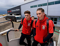 CARDIFF, WALES - Saturday, June 10, 2017: Wales' Daniel James and Harry Wilson board the team plane as the squad depart Cardiff Tesla Airport to travel to Belgrade ahead of the 2018 FIFA World Cup Qualifying Group D match against Serbia. (Pic by David Rawcliffe/Propaganda)