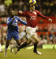 Photo: Aidan Ellis.<br /> Manchester United v Chelsea. The Barclays Premiership. 26/11/2006.<br /> United's Ryan Giggs gets away from Chelsea's Claude Makelle