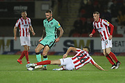 Christie Elliott is tackled by Jacob Greaves   during the EFL Sky Bet League 2 match between Cheltenham Town and Carlisle United at Jonny Rocks Stadium, Cheltenham, England on 20 August 2019.