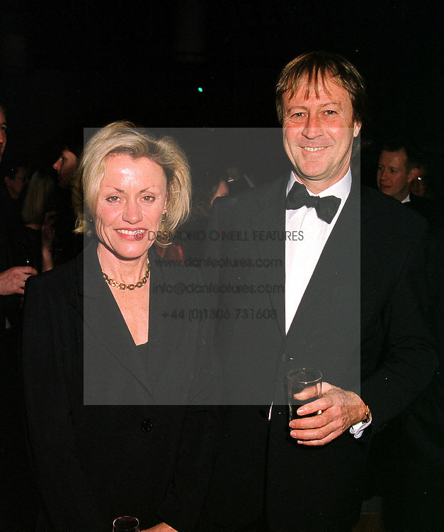 MR & MRS BILL MUIRHEAD he is Managing Director of M&C Saatchi, at a dinner in London on 26th January 2000.OAK 7