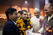 27 year old sailor Jaswinder Singh's extended family garland him as they come from various neighbouring states to receive him from the Delhi airport on 29 December 2012 after his release from almost 32 months of being held hostage by Somali pirates who hijacked MV Iceberg 1, a Dubai-owned ship, off the Yemeni coast in March 2010. It was the longest-held hijacked ship until the Puntland Maritime forces released it and 22 crew members on 23 December 2012. Photo by Suzanne Lee / The National