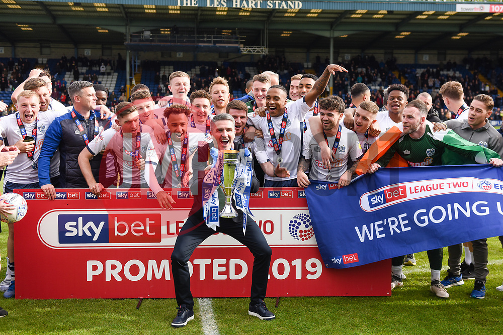 Bury manager Ryan Lowe lifts the trophy as Bury celebrate promotion - Mandatory by-line: JMP - 04/05/2019 - FOOTBALL - Gigg Lane - Bury, England - Bury v Port Vale - Sky Bet League Two
