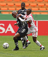 Sibusiso Vilakazi and THULANI SERERO Challenge for the ball during the PSL match between Ajax Cape Town and Bidvest Wits held at Newlands Stadium in Cape Town on 13 September2009 ..Photo by Shaun Roy/www.sportzpics.net.+27 21 785 6814..