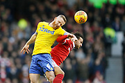 Leeds United midfielder Adam Forshaw (4) beats Nottingham Forest midfielder Joao Carvalho (10) in the air during the EFL Sky Bet Championship match between Nottingham Forest and Leeds United at the City Ground, Nottingham, England on 1 January 2019.