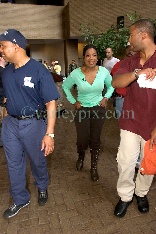 04 Sept  2005. New Orleans, Louisiana. <br /> Post hurricane Katrina.<br /> Oprah Winfrey, US talk show host, visits the Hyatt Hotel in New Orleans as she prepares to survey the hurricane damage. Here surrounded by her security detail.<br /> Photo Credit &copy;: Charlie Varley/varleypix.com