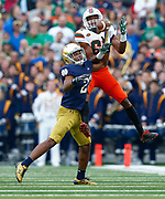 SOUTH BEND, IN - OCTOBER 29: Ahmmon Richards #82 of the Miami Hurricanes fights for the ball with Julian Love #27 of the Notre Dame Fighting Irish defends at Notre Dame Stadium on October 29, 2016 in South Bend, Indiana.  (Photo by Michael Hickey/Getty Images) *** Local Caption *** Ahmmon Richards; Julian Love