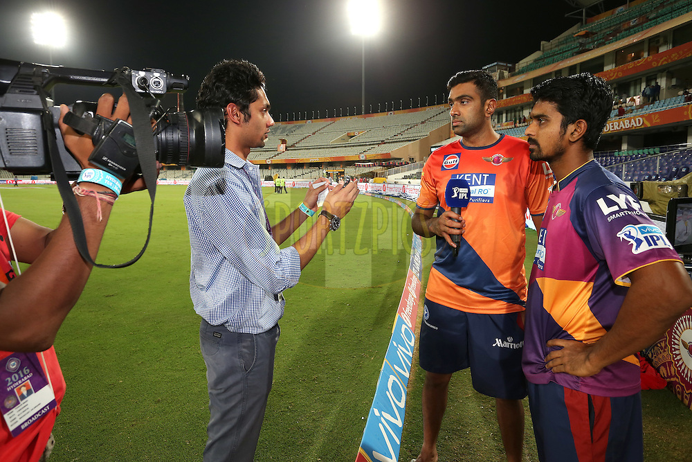 Ravichandran Ashwin of Rising Pune Supergiants and M. Ashwin of Rising Pune Supergiants are interviewed after the match during match 22 of the Vivo IPL 2016 (Indian Premier League) between the Sunrisers Hyderabad and the Rising Pune Supergiants held at the Rajiv Gandhi Intl. Cricket Stadium, Hyderabad on the 26th April 2016<br /> <br /> Photo by Shaun Roy / IPL/ SPORTZPICS