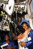 A brand new CJ alumna gets a hug and some balloons following the Chaminade Julienne High School Class of 2012 commencement exercises at the Schuster Center in downtown Dayton, Monday, May 21, 2012.