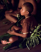 One of the schoolchildren performing at a meke on Kadavu Island, Fiji.