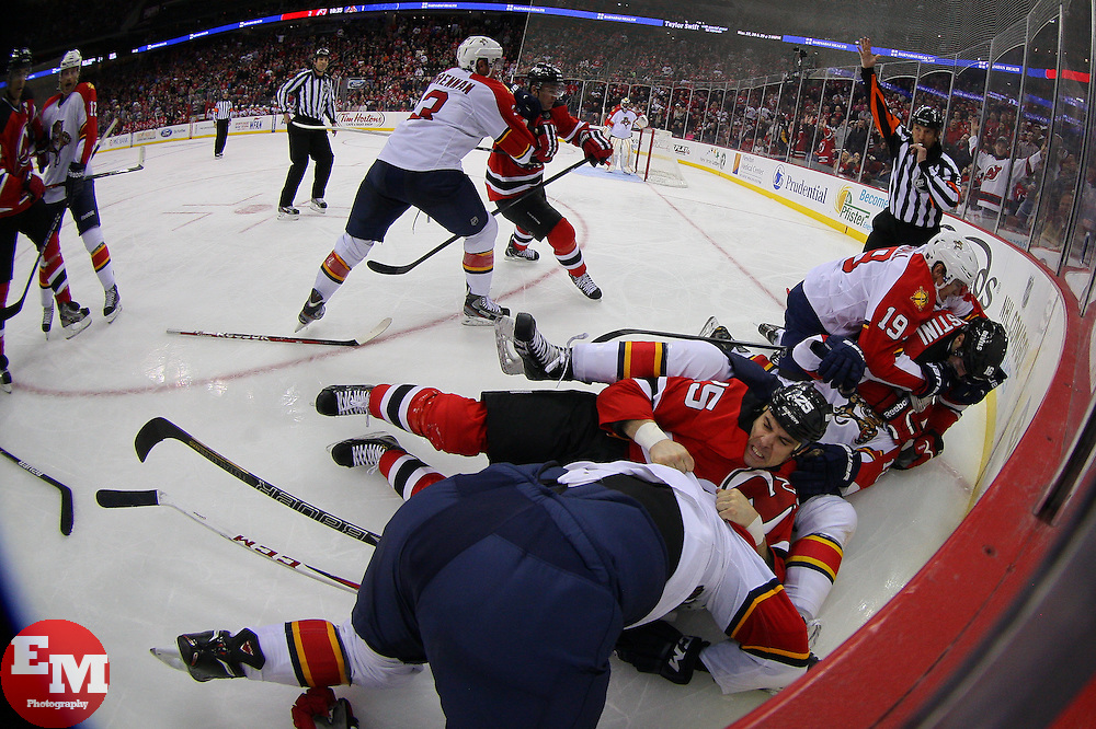 Mar 23, 2013; Newark, NJ, USA; The New Jersey Devils and Florida Panthers fight after Florida Panthers defenseman Colby Robak (47) cross-checked New Jersey Devils center Tim Sestito (15) from behind during the third period at the Prudential Center. The Devils defeated the Panthers 2-1.
