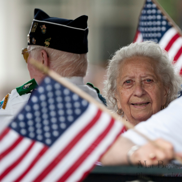 Members of American Legion Post 521 in Washington Township wave  to the crowd during Pitman's annual 4th of July parade held in downtown Pitman monday.