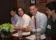 """From left: Cory Cotsonas, Nathan Kocan, Tyler Ondo, and Dan Aguirre participate in the Ohio University Homecoming """"Dinner with 12 Strangers"""" event at Sol on Oct. 8, 2014. Photo by Lauren Pond"""