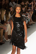 A sequined black dress with fringge skirt and brocase epaulets. By Carlos Miele at the Spring 2013 Mercedes-Benz Fashion Week in New York.