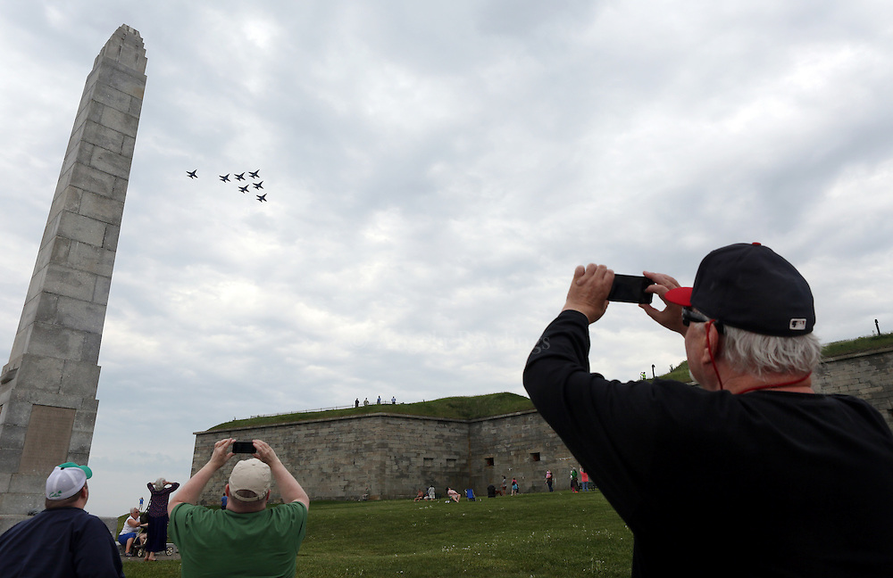 (Boston, MA - 5/26/15) People take photos as the Blue Angels fly in formation over Castle Island, Tuesday, May 26, 2015. Staff photo by Angela Rowlings.
