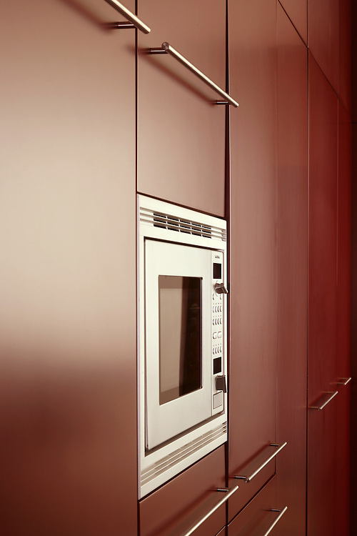 red kitchen units with built in microwave