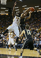 February 27 2013: Iowa Hawkeyes center Gabriel Olaseni (0) and Purdue Boilermakers guard Anthony Johnson (1) battle for a rebound during the first half of the NCAA basketball game between the Purdue Boilermakers and the Iowa Hawkeyes at Carver-Hawkeye Arena in Iowa City, Iowa on Wednesday, February 27 2013.