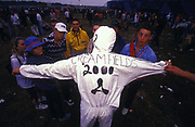 A clubber with white jumpsuit at Creamfields, Liverpool, UK, 2000.