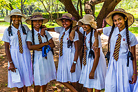 School girls in unifotm, Sacred Quadrangle, Ruins of ancient city, Polonnaruwa, Sri Lanka.