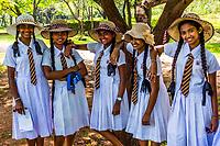 School girls in unifotm, Sacred Quadrangle, Ruins of ancient city, Polonnaruwa, Sri Lanka.